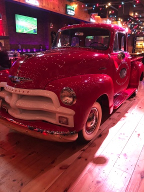 "An antique Chevy in ""George Jones bar'"""
